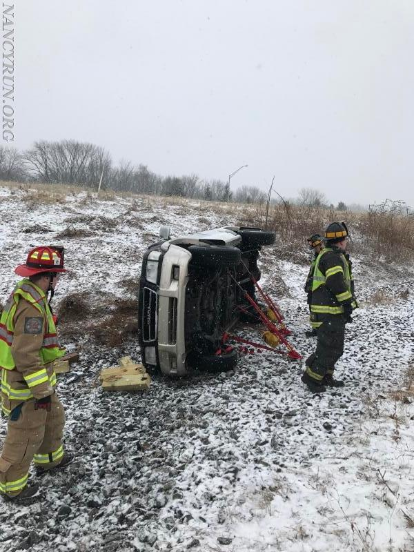 Rescue company after freeing a trapped patient from an overturned SUV on the Interstate.